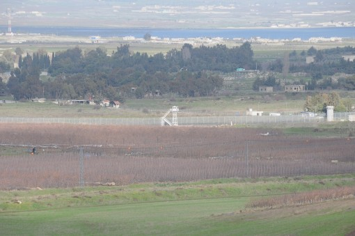 one of the most fortified borders on earth between Syria and occupied Golan Heights